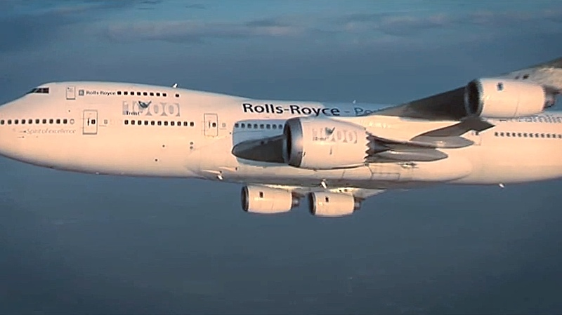 A demonstrator wide-body jet plane flying with Rolls-Royce engines