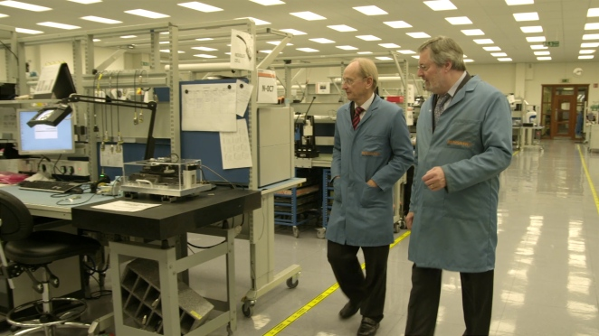 Sir David McMurtry (left) and John Deer inside one of the Renishaw production areas.